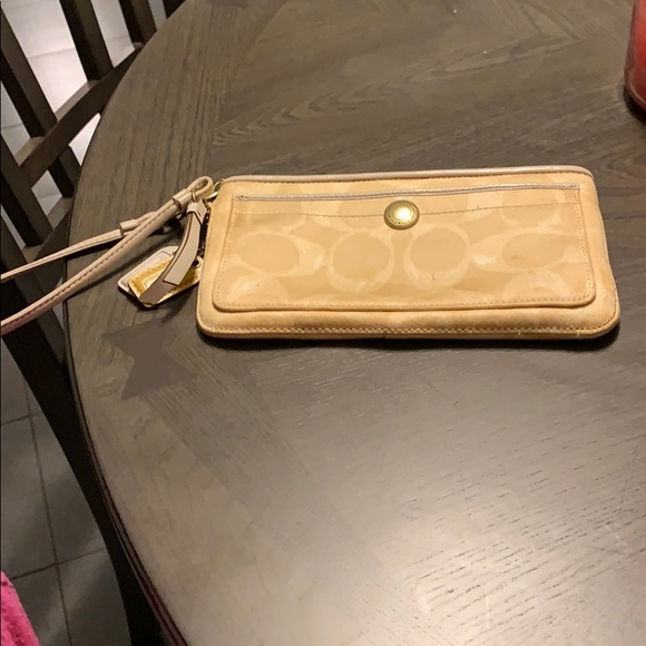 Coach Handbags - Tan and white wrislet